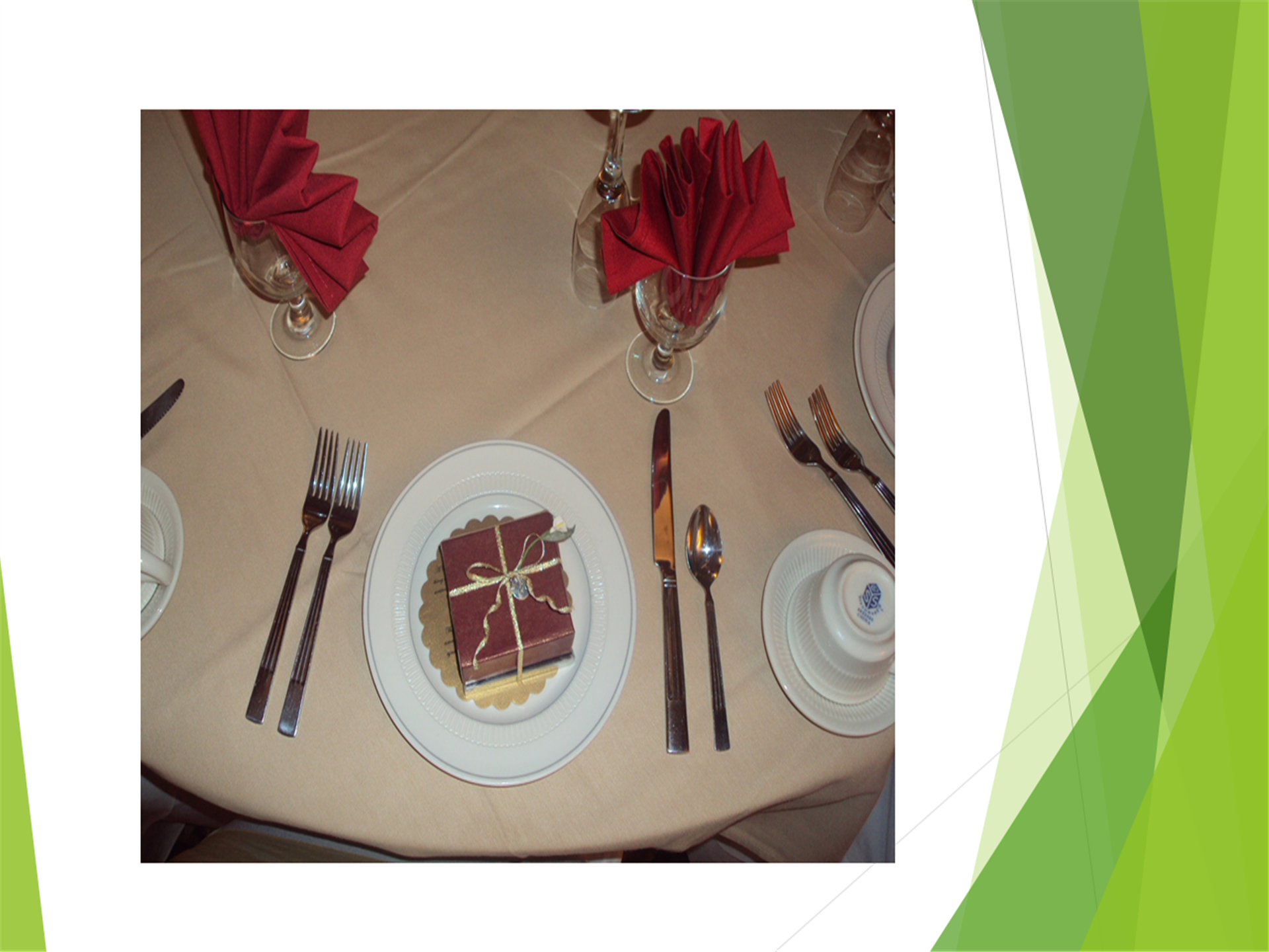 table setting with plate, silverware, water glass, napkin and party favor.