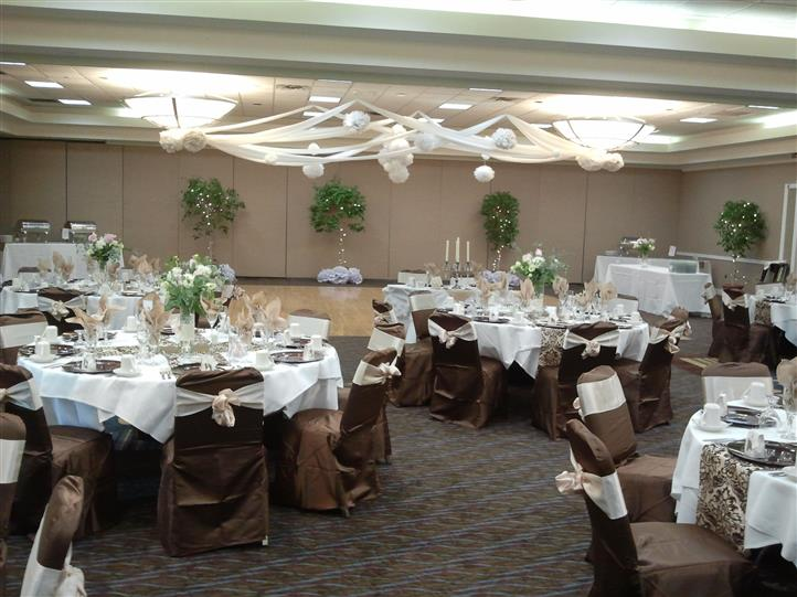 Covered tables and chairs at wedding event in banquet room