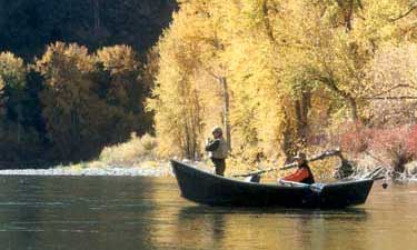 men in small boat fishing