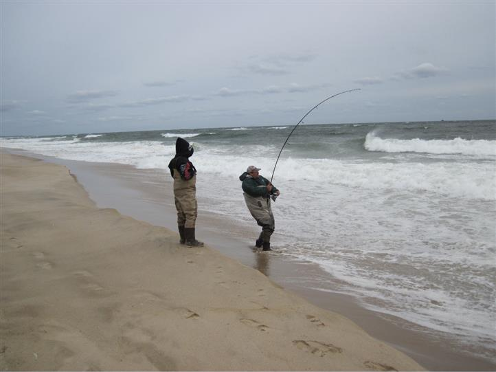 Two men surfcasting