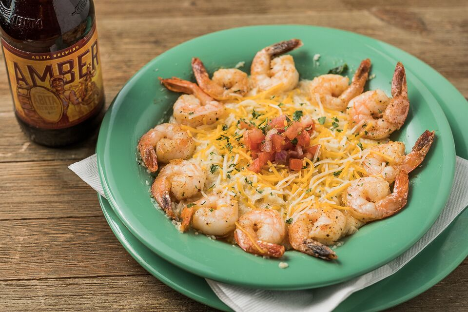 Bowl of grilled shrimp and shredded cheese