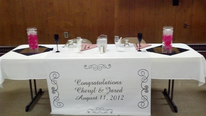 """catering table with sign that reads """"Congratulations Cheryl & Jared, August 11, 2012"""""""