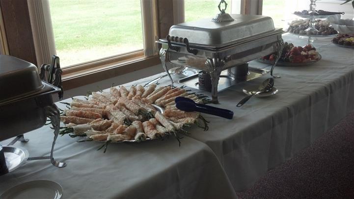 catering tables with plate of rolls