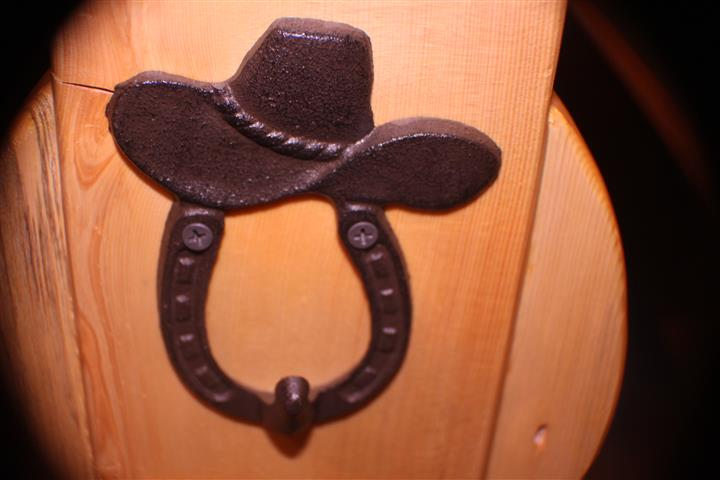 wall art of iron horse-shoe with cowboy hat