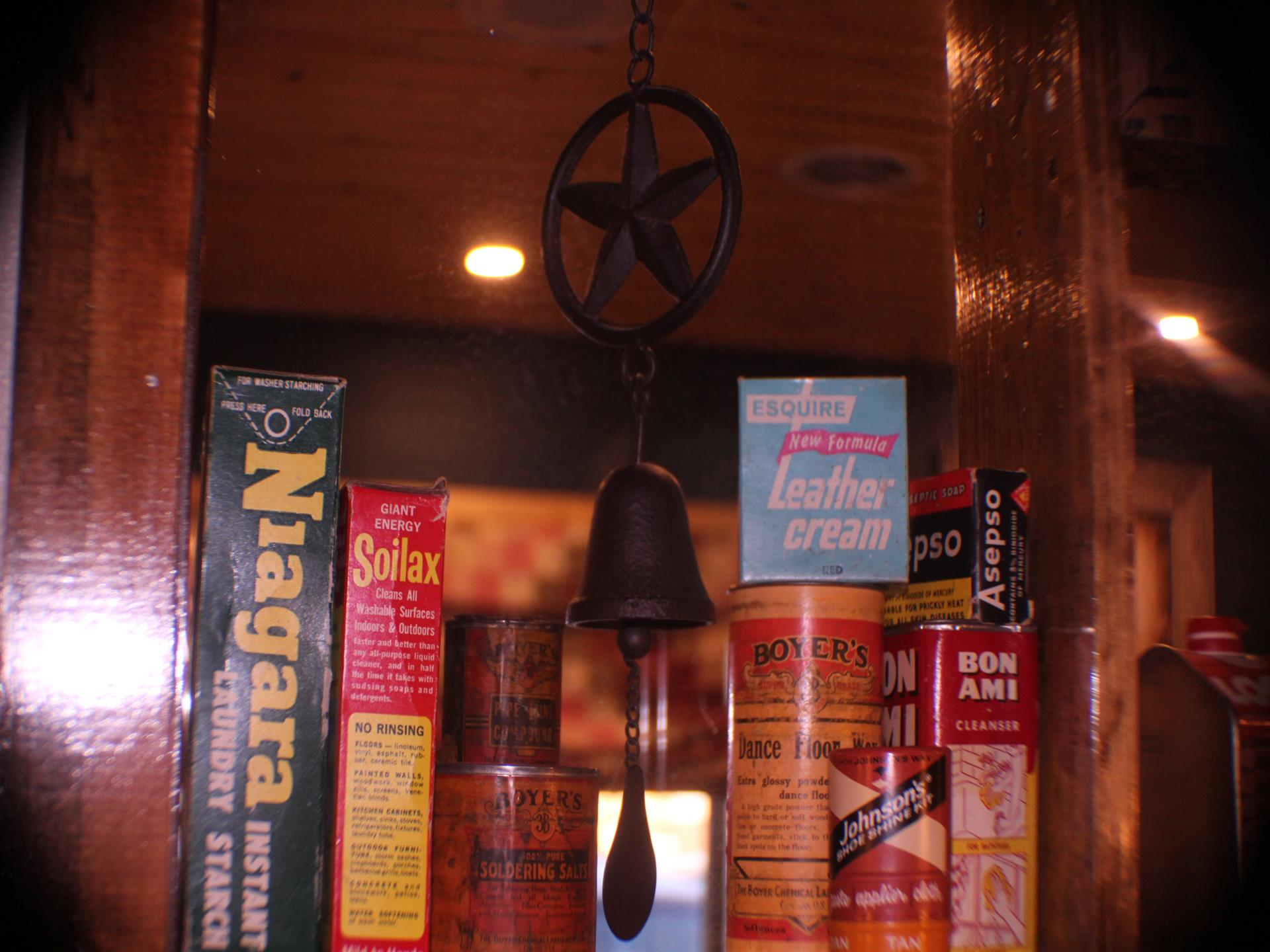 shelf with books, and iron bell