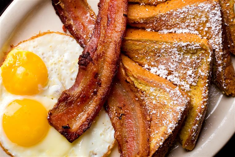 eggs, bacon, and french toast on a plate