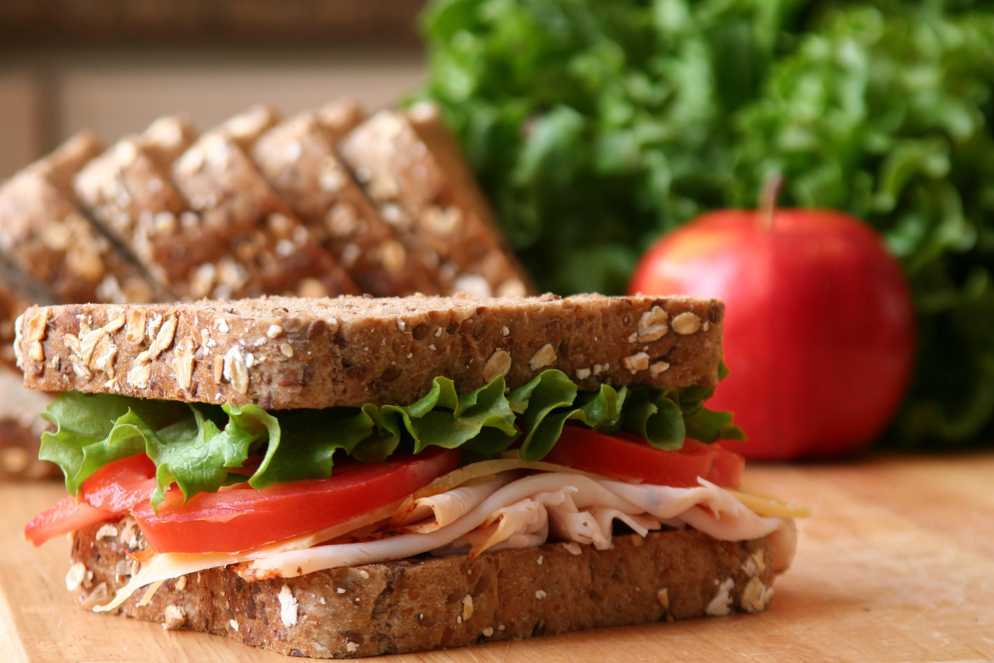 Turkey sandwich on whole wheat bread with lettuce and tomato