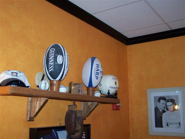 guinness and harp sports memorabilia on a shelf