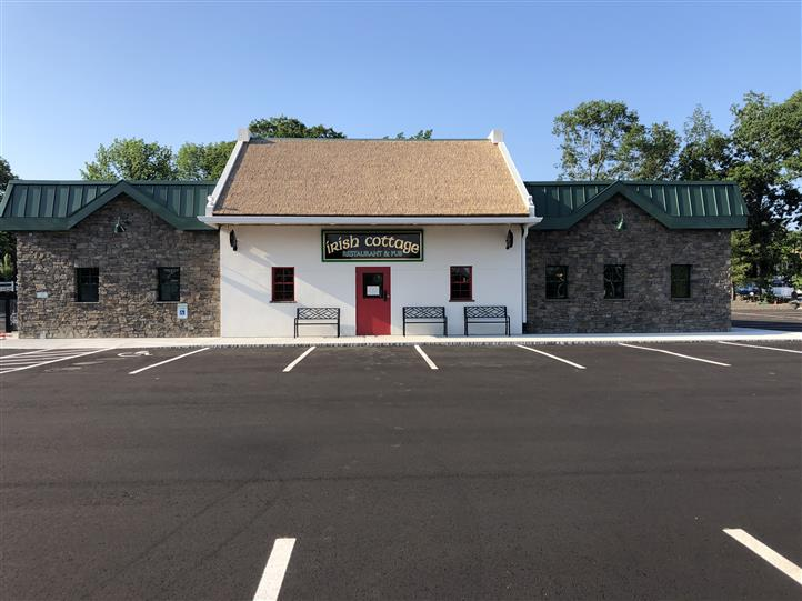 exterior building to the irish cottage viewed from an empty parking lot