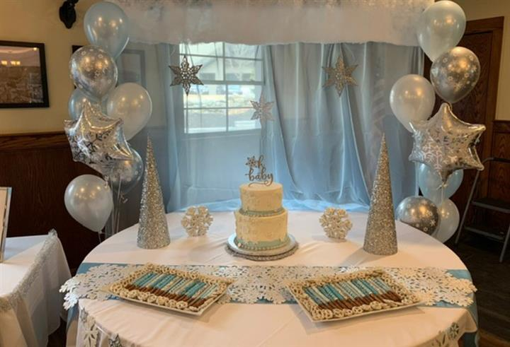 baby shower event with balloons, cake and decorations