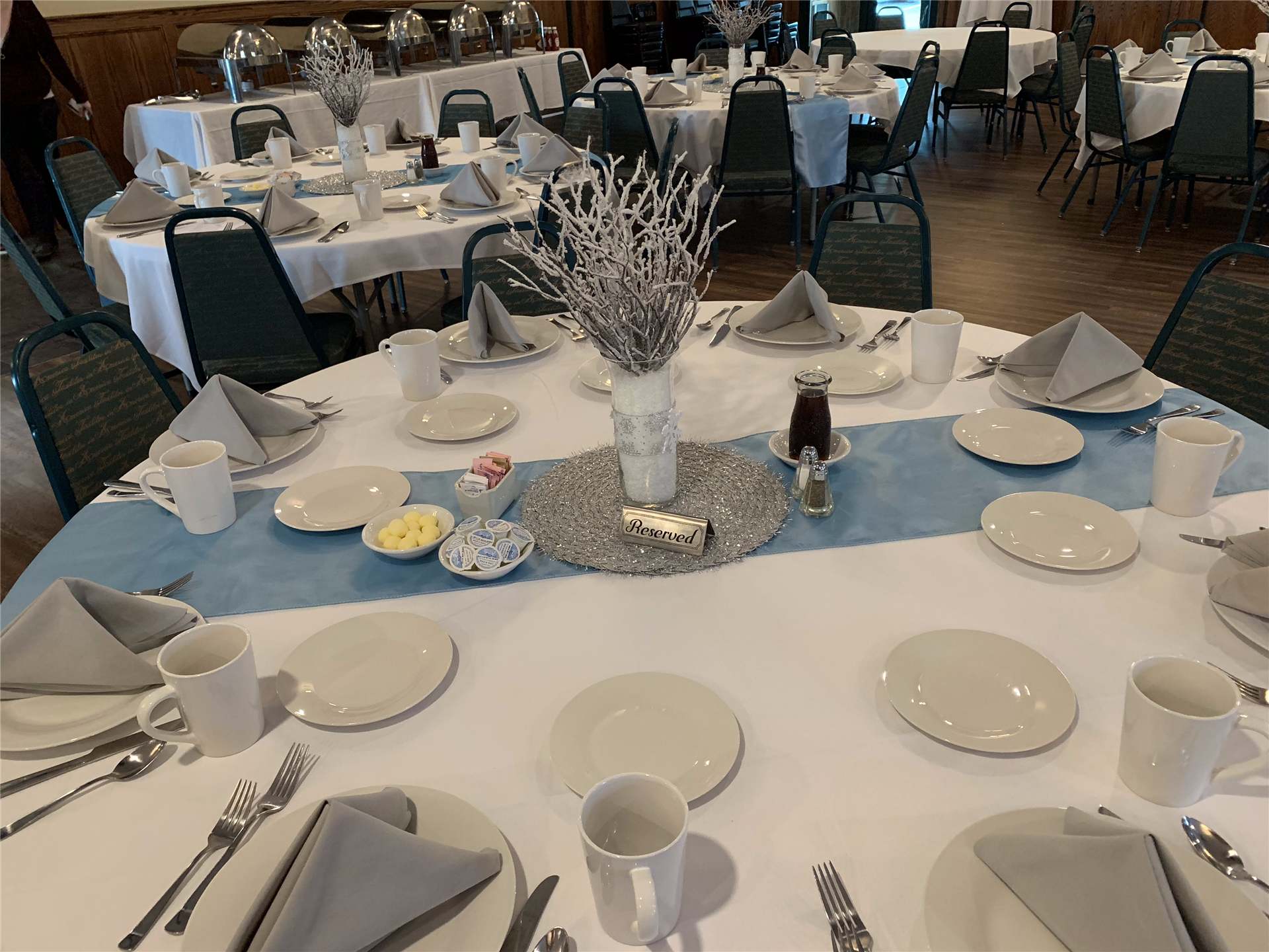 Round table with plates and silverware