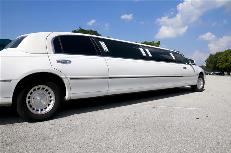 White stretched limousine in parking lot