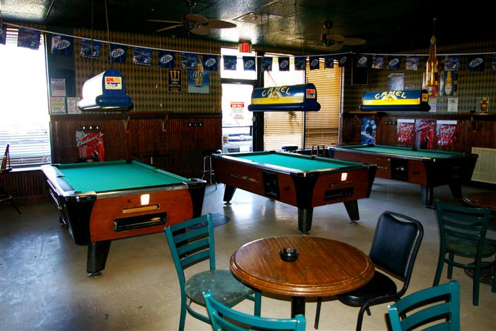 interior bar area with pool tables, tables and chairs