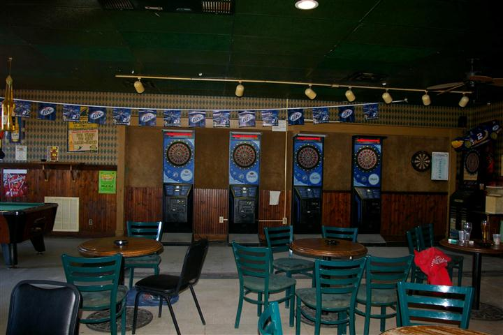 interior bar area with dart boards, tables and chairs