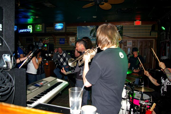 band performing inside the crowded bar