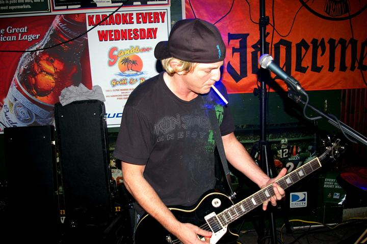 guitarist performing inside the bar on a live set