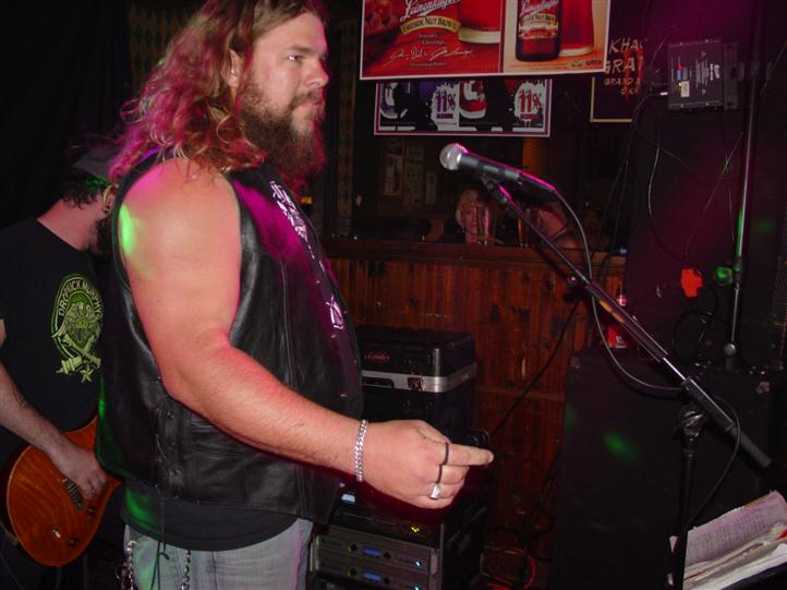 lead singer performing inside the bar