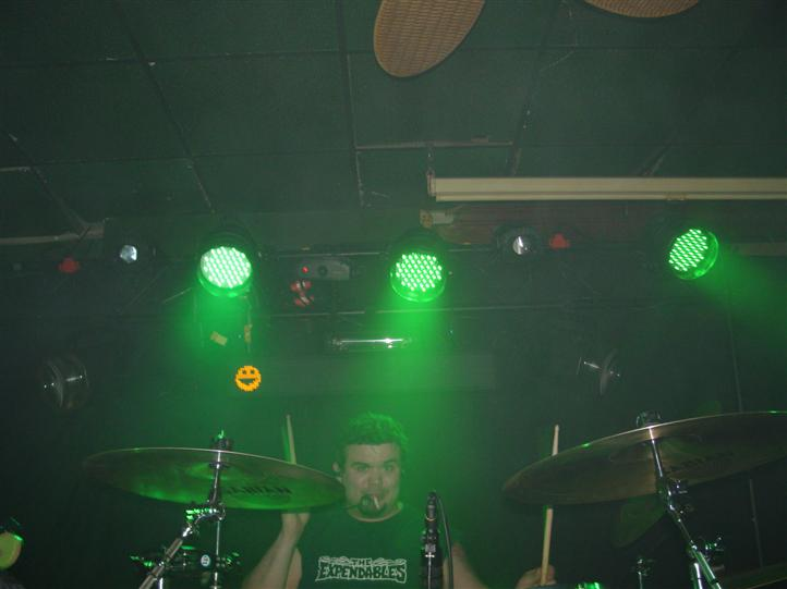 drummer performing inside the bar for a live set