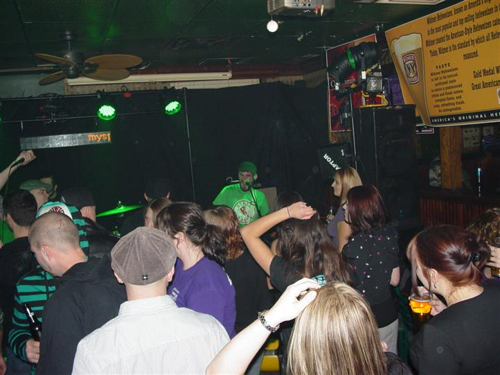 live band performing inside the crowded bar