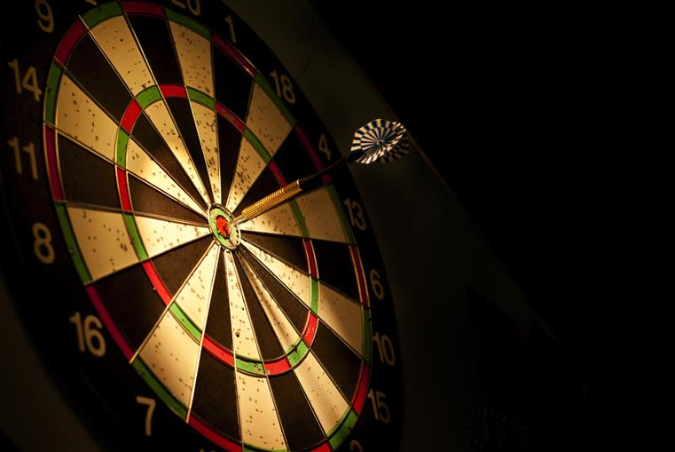 Dartboard with bullseyed dart