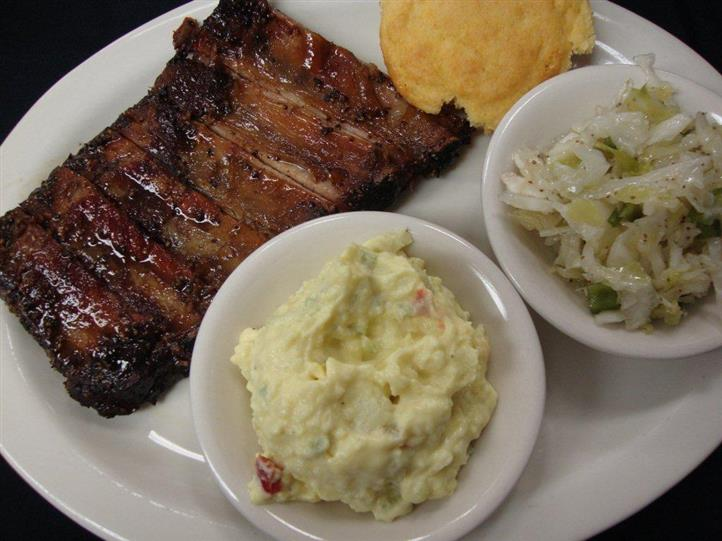 Pork ribs served with two side salads