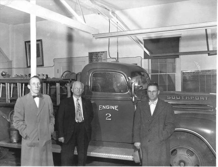 Firemen Standing in front of Fire Truck