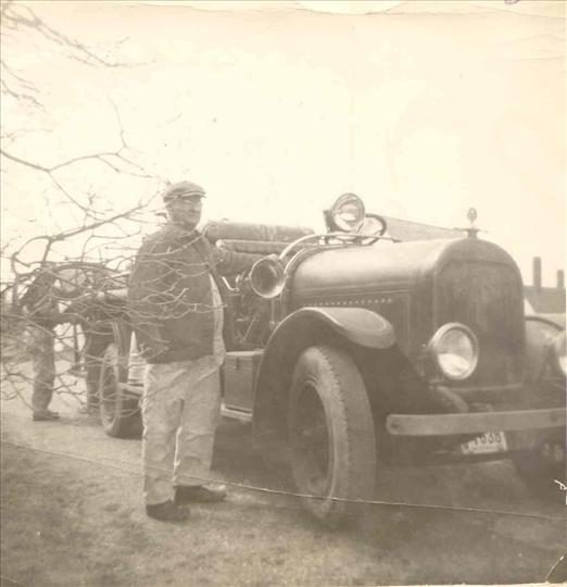 Man standing in front of First Fire Engine