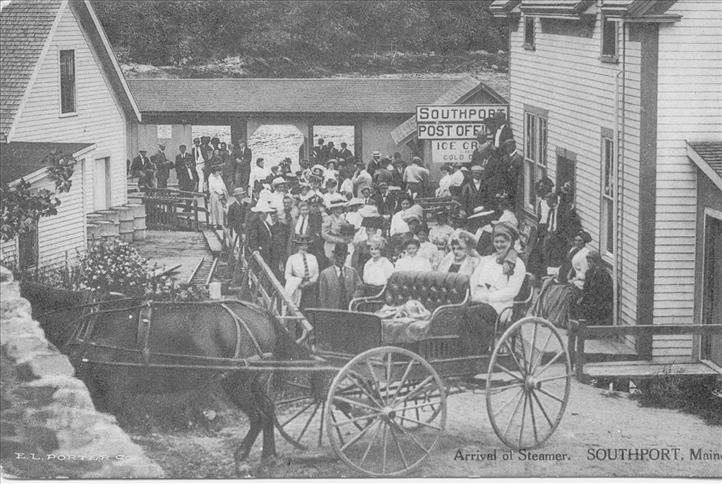 Group of people in front of post office with horse and carriage