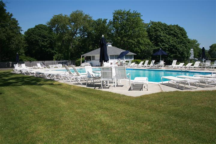 Pool with pool chairs and umbrellas