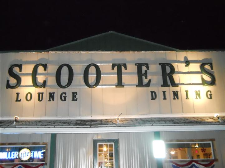 exterior of scooter's lounge and dining with signage above door