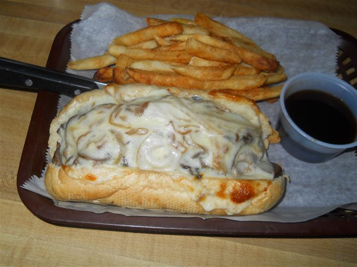 cheesesteak with fries and dipping sauce