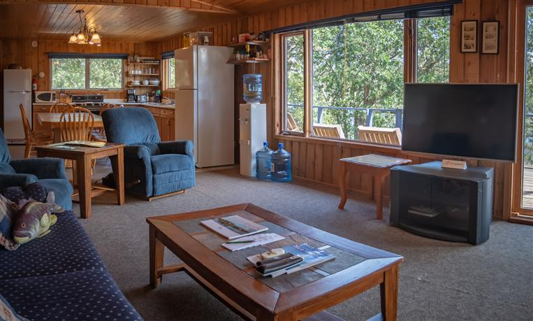 View of living room and kitchen of the French Portage Outpost Cabin.