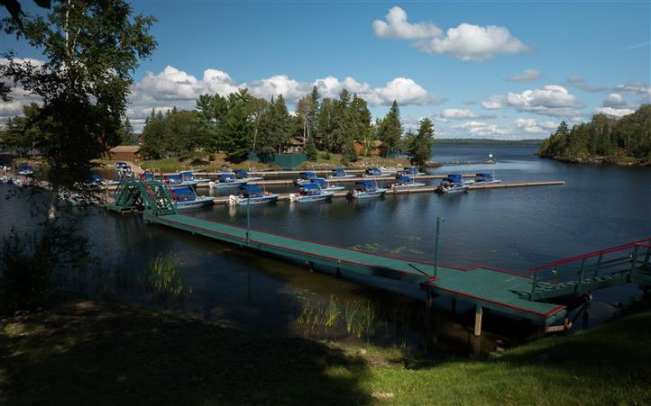 wide view of the boats all docked in the lake