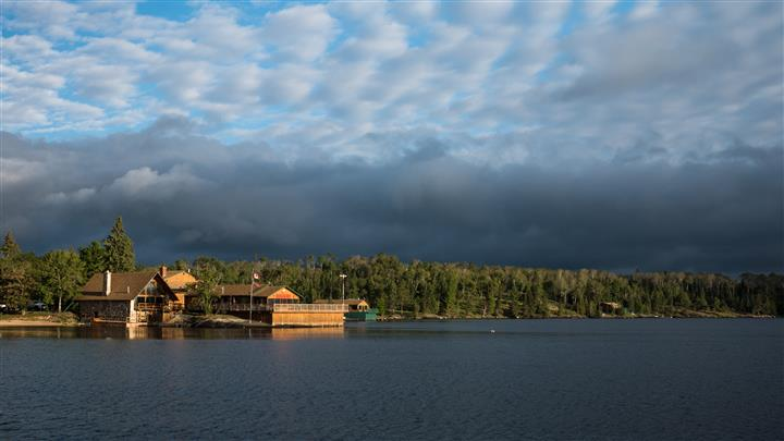lake view of the lodge during a cloudy morning