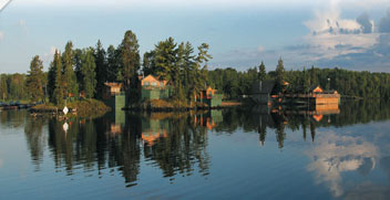 clam lake with trees and cabins around it