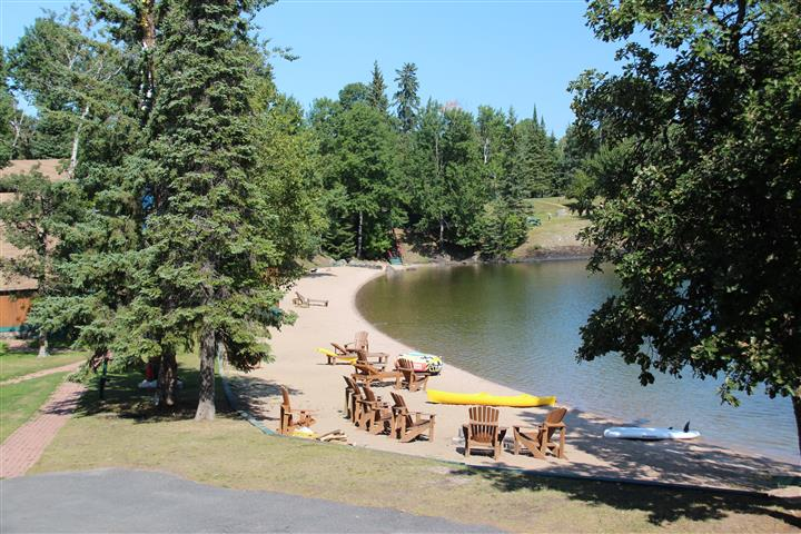 Totem Lodge Resort lake view with chairs and trees