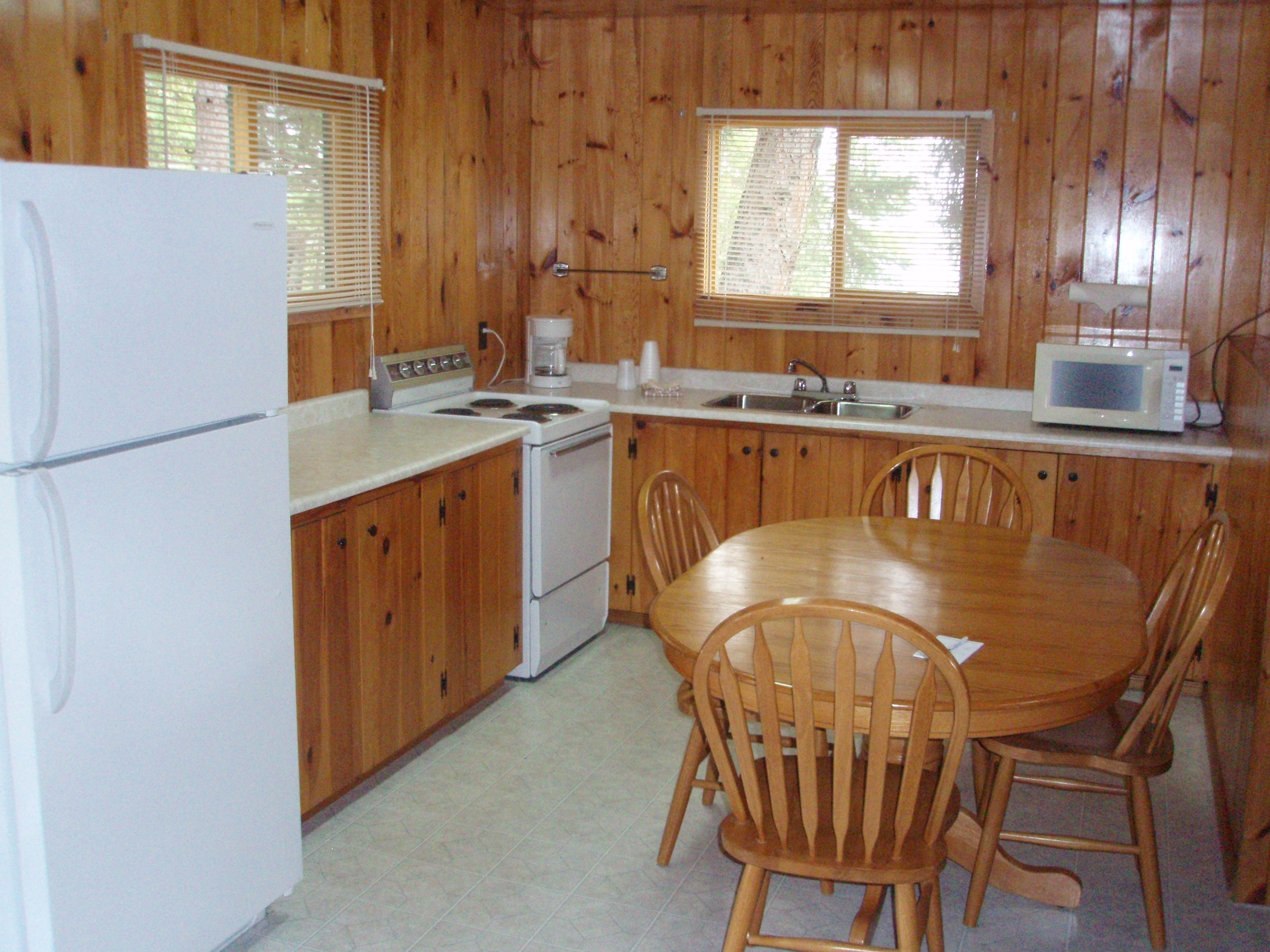 kitchen with table and chairs inside one of the cabins