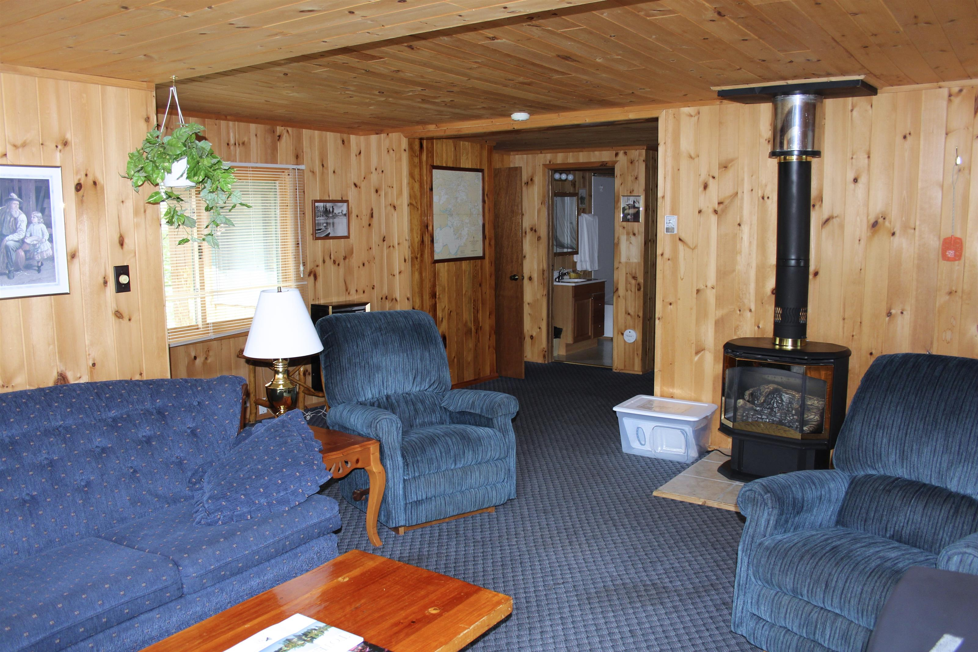 inside one of the cabins with a chair, couch and a table