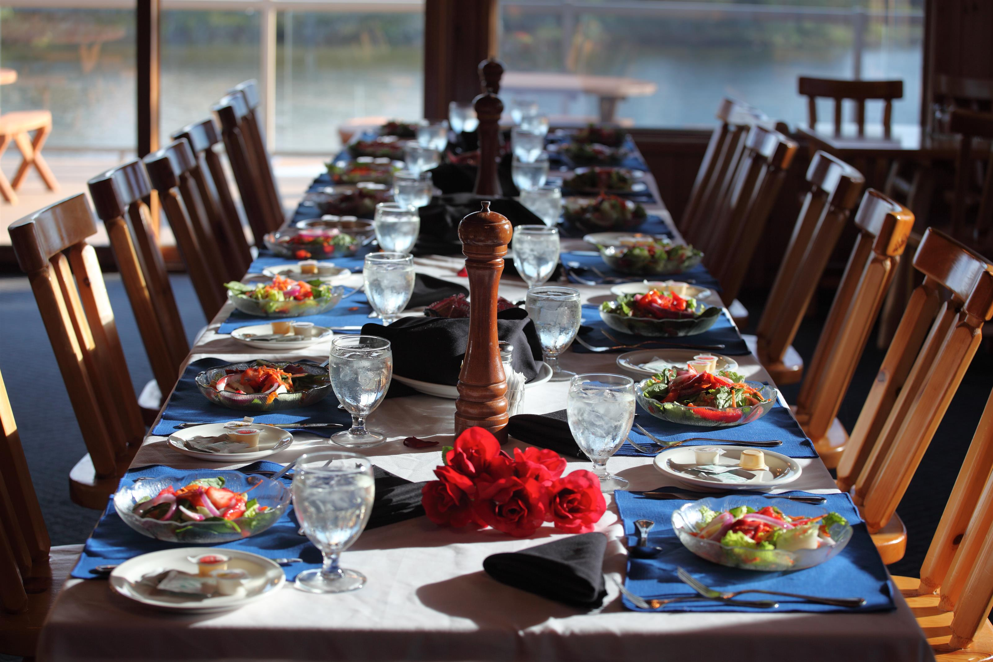 long table in the dining area of the lodge set up for a special event