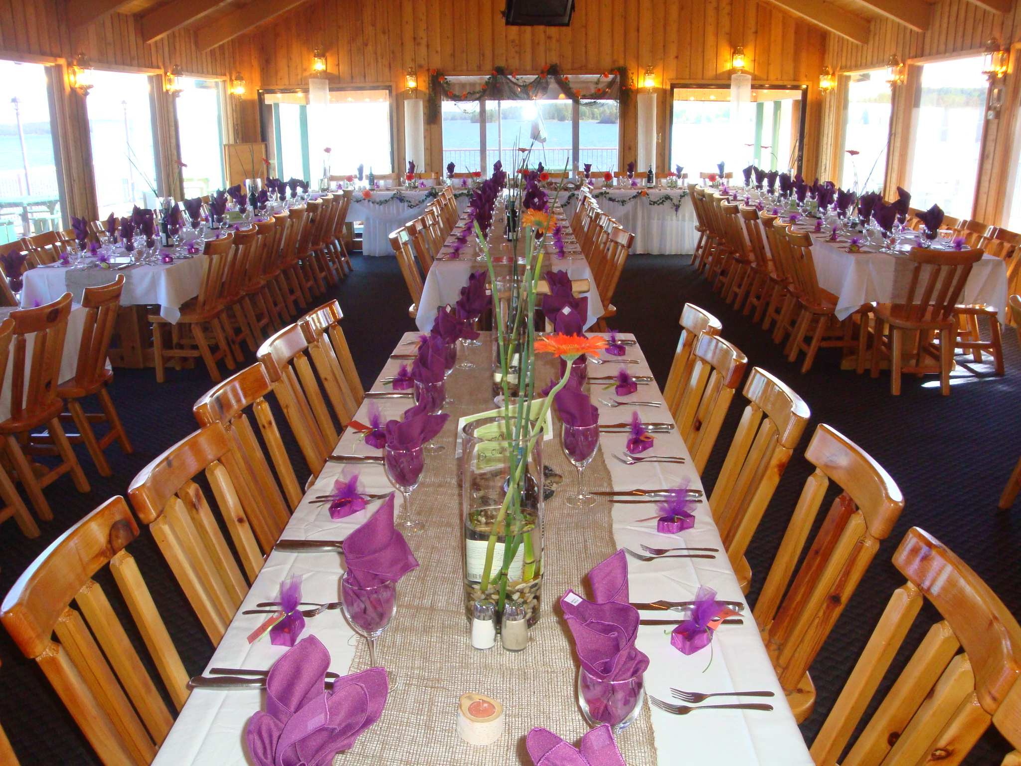 dining area set up for a special event with long tables and chairs