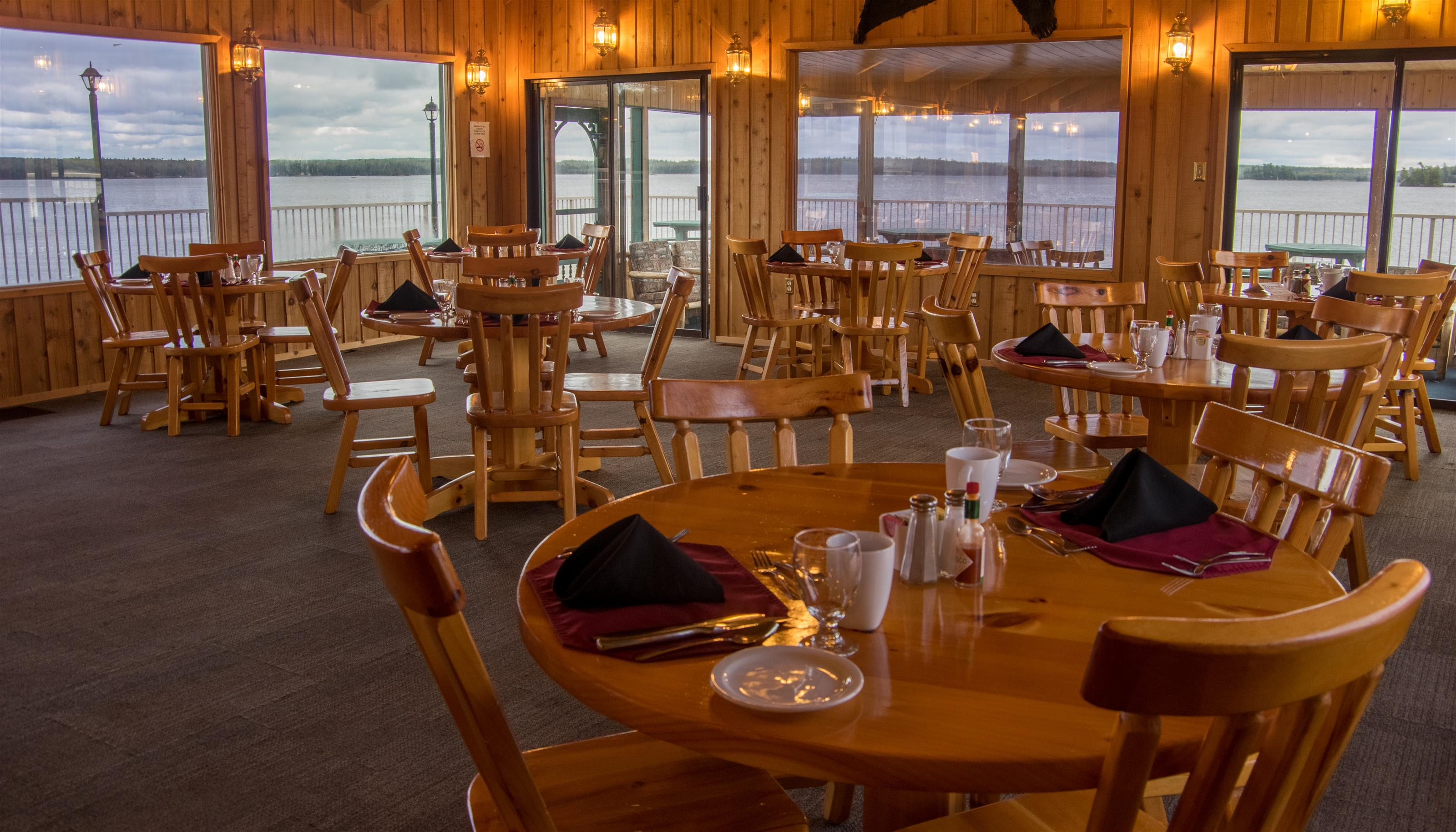 dining area of the lodge set up with tables and chairs