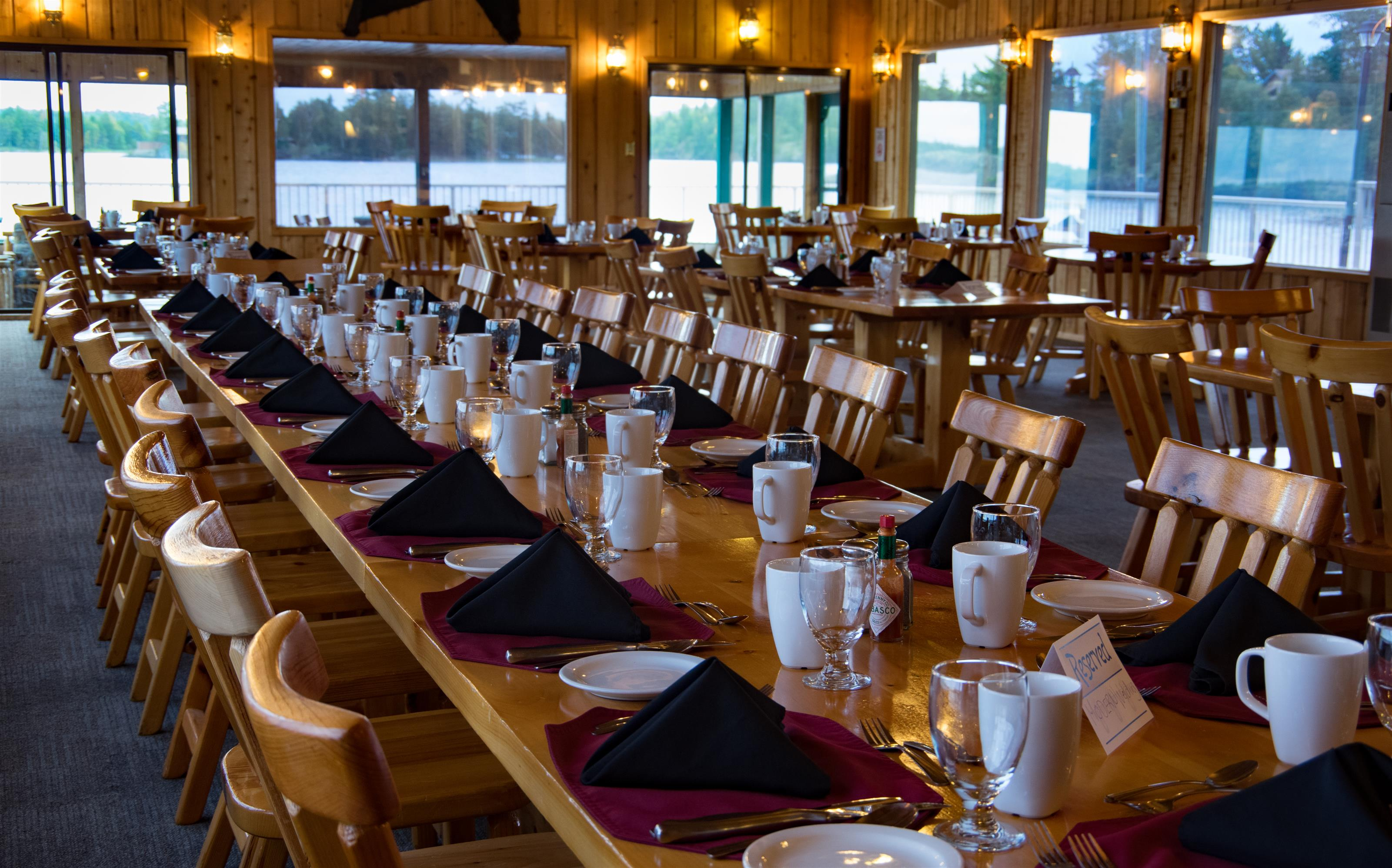 long dining table inside the totem lodge set up for an event