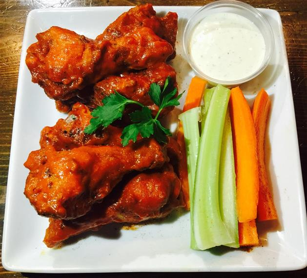 Buffalo Wings with Celery and carrot sticks with a side of ranch