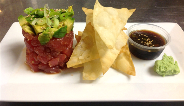 Hawaiian Ahi Poke. Cubed Ahi tuna in our signature poke marinade, avocado, green onions and wonton crisps.