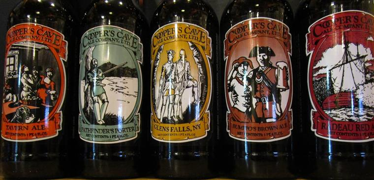 bottles of beer with cooper's cave logo on them
