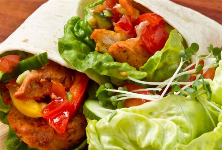 Wraps with tomato lettuce, tomatoes, and grilled chicken