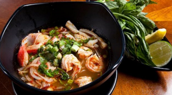 Soup consisting of shrimp, other seafood, vegetables and noodles.