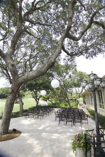 outdoor shot of wedding reception, chairs and lights set up