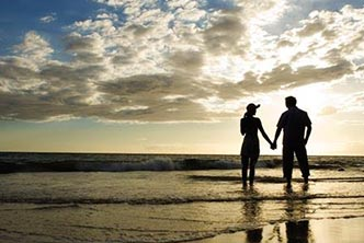 "Silhouetted couple holding hands on beach with captionm, ""where memories are made..."""