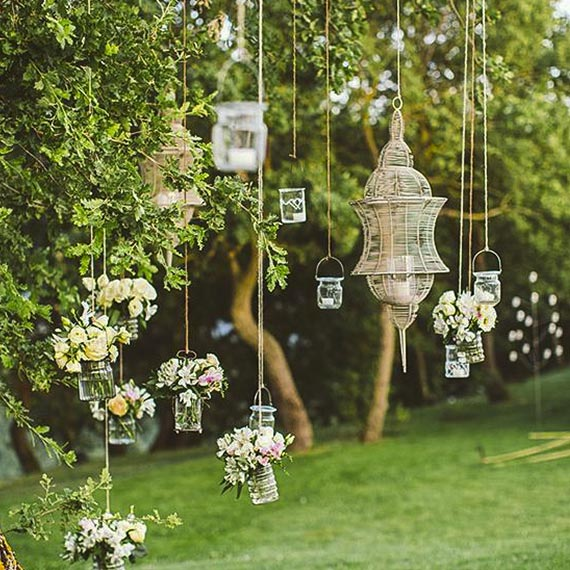 Lanterns hung on strings in yard